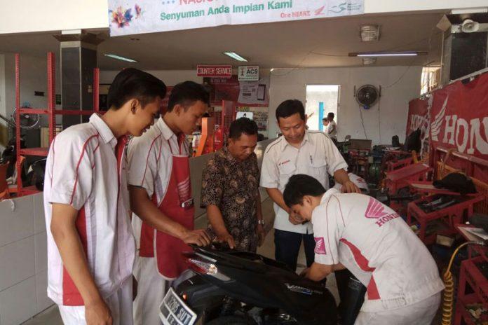 Pasar Spare Part Naik 17 Persen, bengkel resmi AHASS