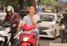 Merokok Saat Naik Motor